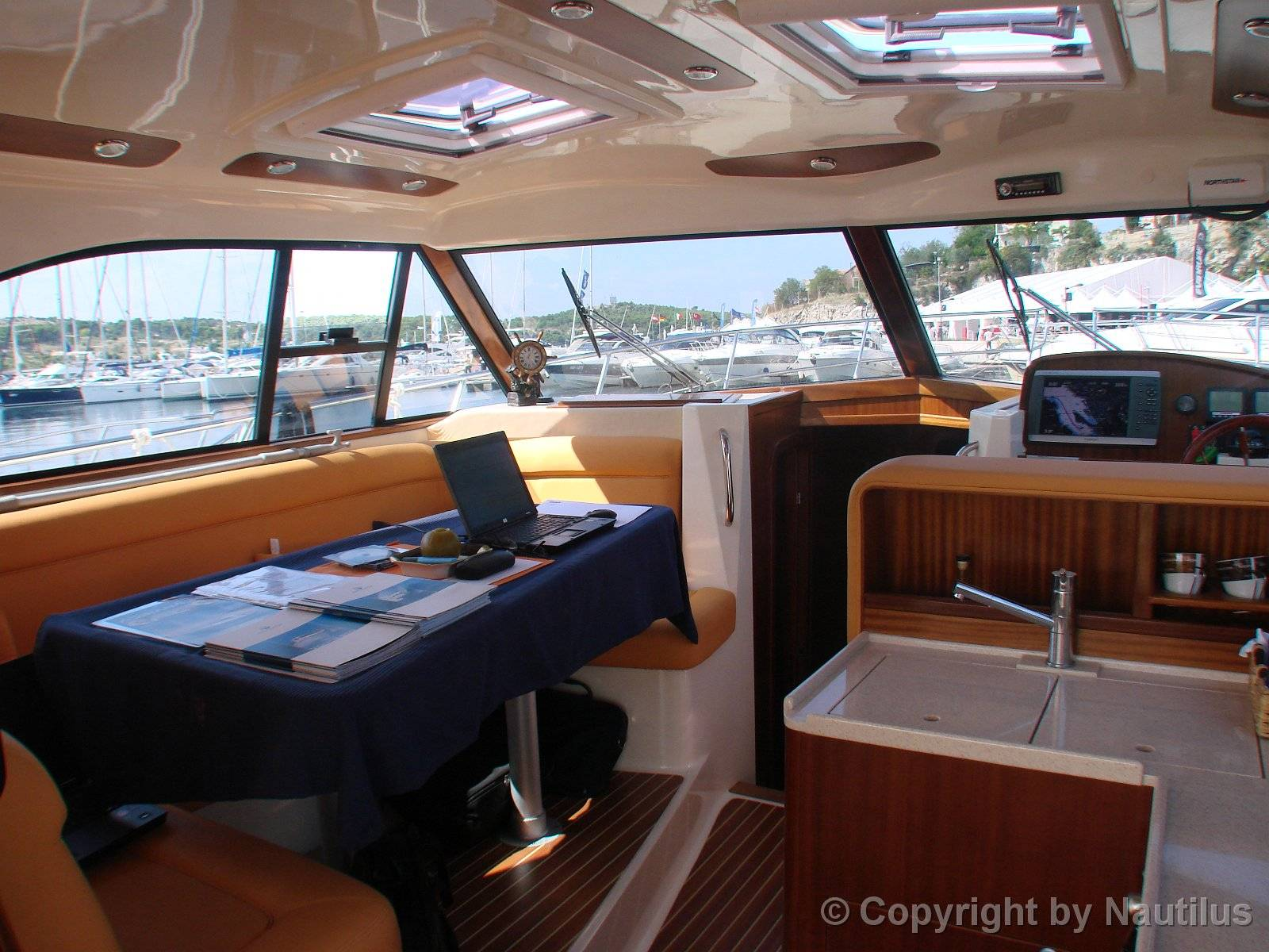 Rent a boat, Adriana 44, table in saloon